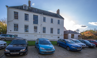 Visitors' cars parked outside Netherclay Residential Care Home